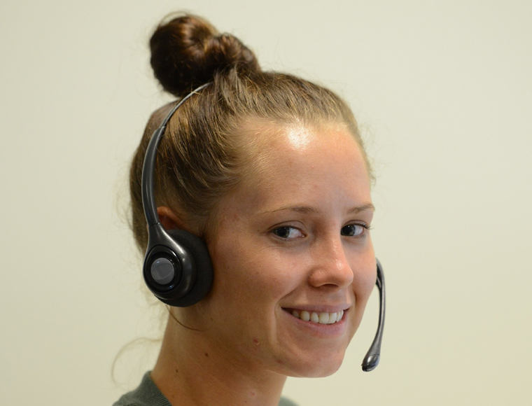 A girl with hands free headset smiling