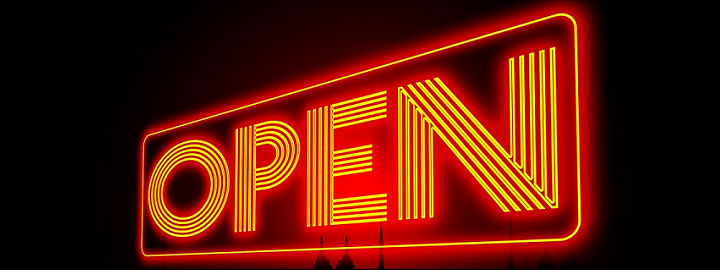 Neon sign reads open