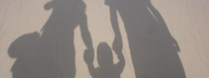 Shadows of family at beach